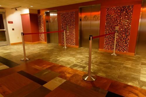 resorts-world-retracta-belt-stanchions-elevator.jpg